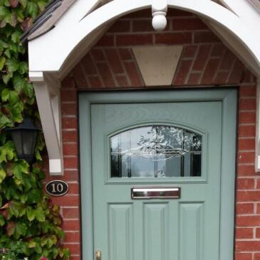 Green pvc door with arch