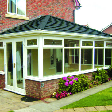 Conservatory in a paved garden